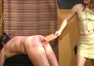 hotty gets her whip for spanking guy on stool